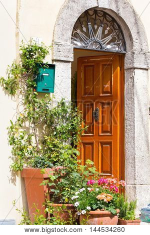 Potted plants at the entrance to a house in the village of Bagni San Filippo, Tuscany, Italy