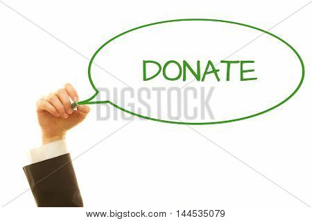 Woman hand writing Donate on a transparent wipe board.