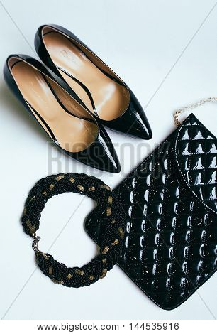Women's handbag and stylish black shoes isolated.