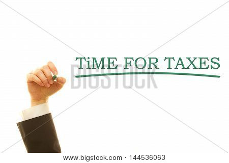 Hand writing Time For Taxes on a transparent wipe board