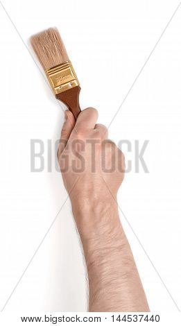 Close-up view of a man's hand with a paint brush, isolated on white background. Painting and decorating. Interior design. Basic repair.