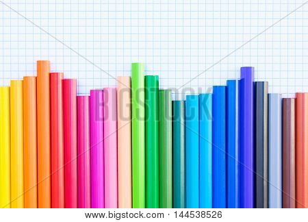 Back to school pencils rainbow on ruled paper background border