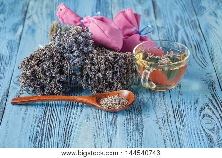Aromatic lavender tea and wild chamomile on table