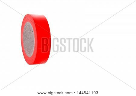 Electrical sticky red insulating tape coil, isolated on white background