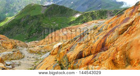 Rocky, colored cliffs in the mountainous area.