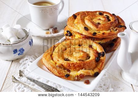French raisin buns and cup of tea