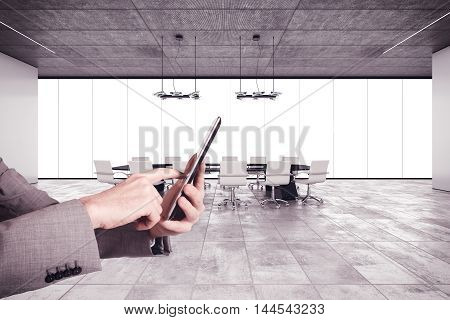 Businessman with cell in a meeting room