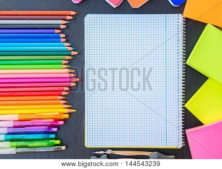 Back to school pencils and pens rainbow and ruled notebook