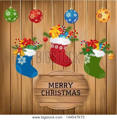 Christmas baubles and stoking with fir branch, candy cane and gifts on wooden background with Merry Christmasgreetings text. Vector.