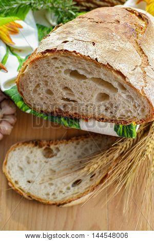 Fresh Italian homemade bread on wooden background