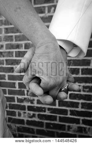 Couple holding hands after having just been married