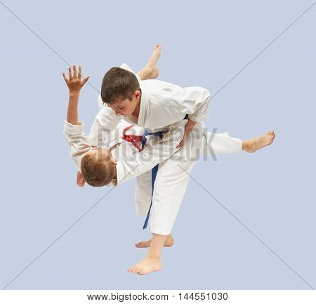 Sportsmen are training high throws of Judo