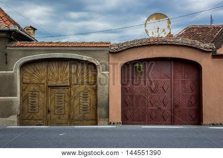 Typical saxon house gates in Miercurea Sibiului town in Romania
