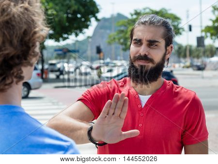 Guy with beard says no to a friend