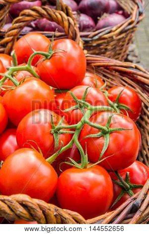 a basket full of ripe juicy tomatoes