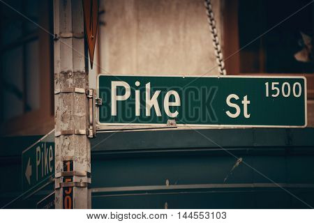 SEATTLE, WA - AUG 14: Pike Street sign in downtown on August 14, 2015 in Seattle. Seattle is the largest city in both the State of Washington and the Pacific Northwest region of North America