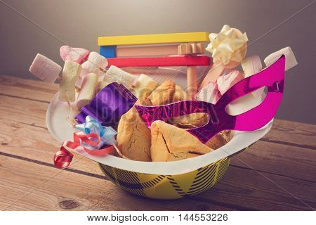 Purim holiday gifts with hamantaschen cookies and candy