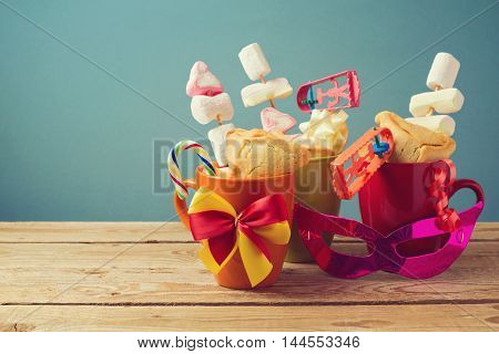 Purim holiday gifts with cookies and candy in cups
