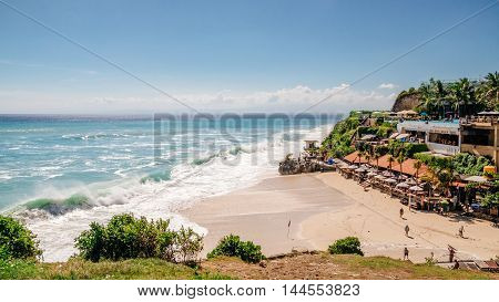 Seascape view with huge waves near beautiful hidden white sand beach, Bali nature, Indonesia