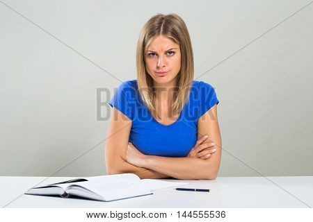 Angry female student is very angry because she has to study.