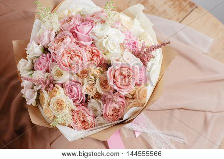 Composition Of Different Varieties Roses. Florist Did Rich Bunch Flowers Light Background, Wooden Su
