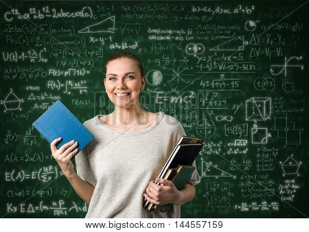 Student girl over  green background with formulas