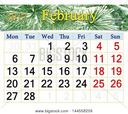 calendar for February 2017 with snowy pine branches in the forest
