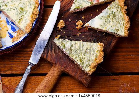 quiche with smocked salmon. style rustic. selective focus