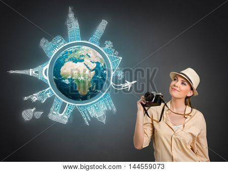 concept travel around the world, tourist with photo camera. Elements of this image are furnished by NASA