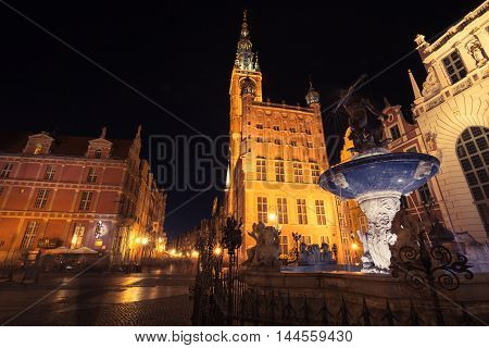 GdanskPoland-September 192015:Gdansk by night in Poland Old Town Long Market illuminated Main Town Hall and Neptune Fountain