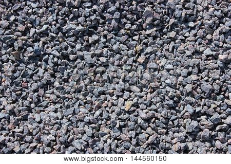 granular surface background with small grey stones