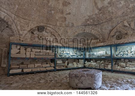 BAR, MONTENEGRO - APRIL 25, 2015: Lapidarium was opened in 2013 in the building of gunpowder warehouse in the old town of Bar. It presents fragments of stone window frames, doorways, columns and other elements of buildings dating from 5 - 9 centuries