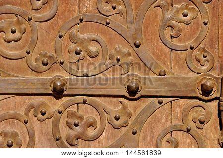 Brown old door with metal ornaments in Jerusalem Israel