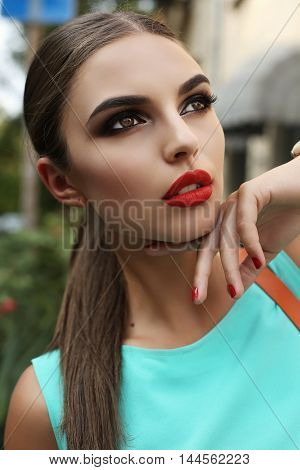 Beautiful Young Woman With Dark Hair And Bright Makeup