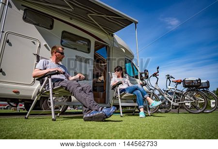 Couple on holiday at a campsite. Caravan car Vacation. Family vacation travel, holiday trip in motorhome
