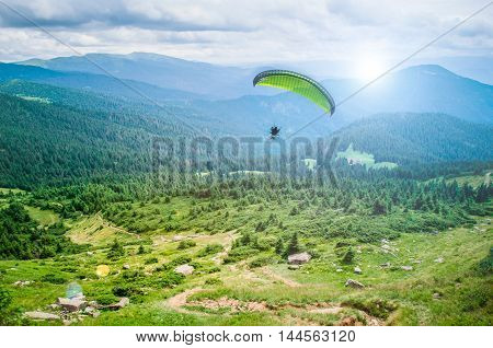 Paragliding with beautiful cloudscape background air runner