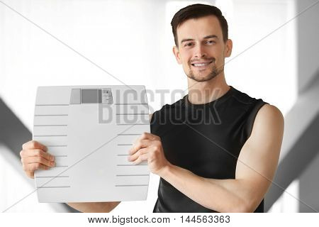 Man holding weight scale