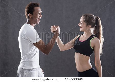 African American Man And Girl Wrestling