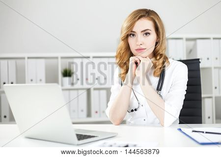 Concentrated Woman Doctor In Office