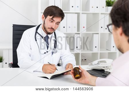 Doctor Thinking About New Drug
