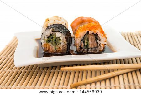 traditional  japanese sushi rolls isolated on white