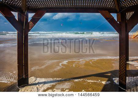 Storm on the Mediterranean Sea in January. Beach canopy on a sea beach in Tel Aviv