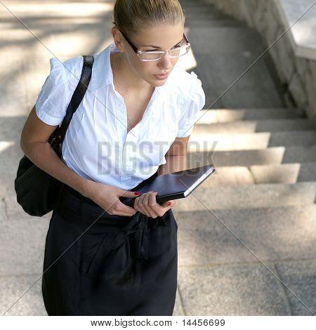 Schoolgirl walking up the ladder
