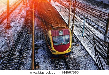 Red modern train and the platform with rails at sunset. top view