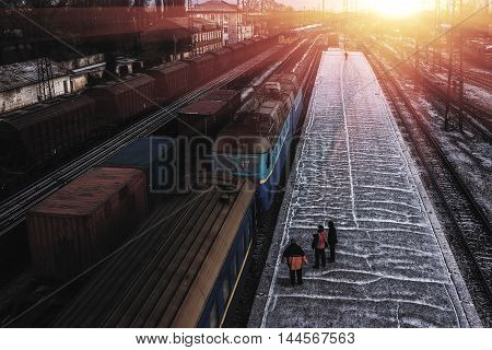 old train with many wagons at sunset