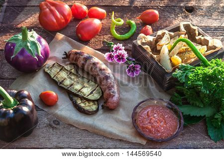 Grilled Sausages And Vegetables In Rustic Style. Selective Focus.