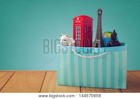 Travel around the world concept. Souvenirs from around the world in shopping bag