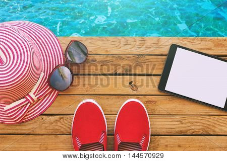 Summer holiday vacation essential objects on wooden deck. View from above