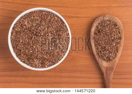 linseed into a bowl over a wooden table