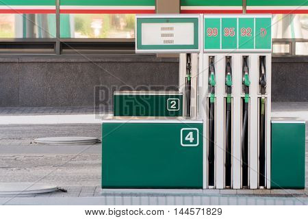 Gas station with two columns and different fuels